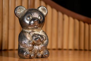 Metallic figure of a big and a small bear