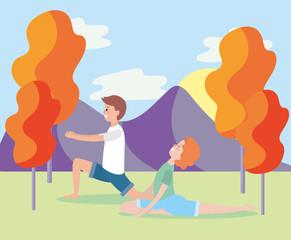 man and woman training yoga pose
