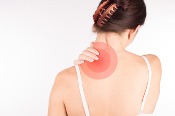 Muscle spasm. Woman with neck and shoulder pain and injury, back view, close up, isolated on white