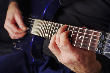Guitarist hands playing guitar