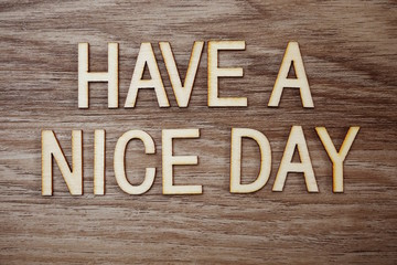Have a Nice Day text message on wooden background