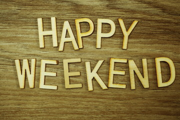 Happy Weekend text message on wooden background