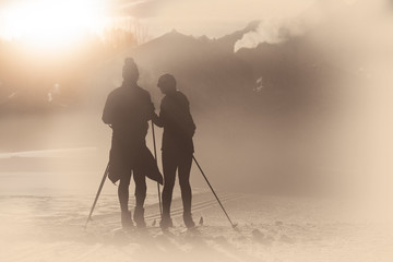 Simulations of old photography with artifacts. Cross-country skiing couple
