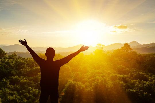 Men raise arms to thank God.