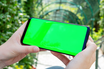 Woman holding modern smartphone mockup