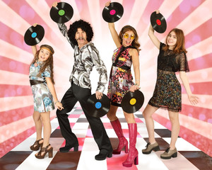 Family dressed in disco style with vinyl records