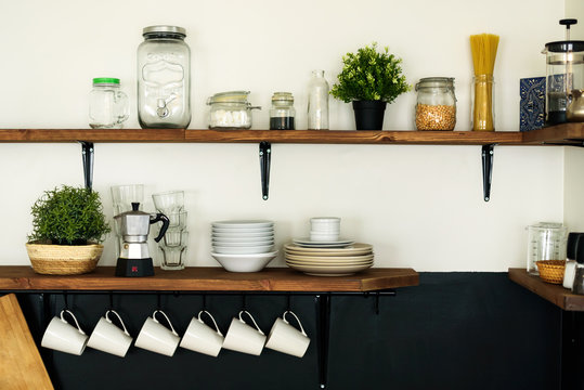 Dish on open shelves in kitchen