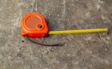 Orange tape measure on the ground floor.