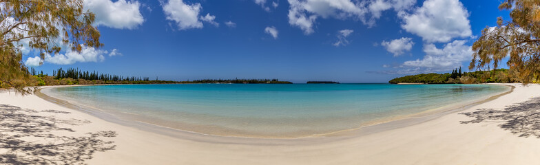 Beautiful smile shaped beach line on the Island of Pines in New Caledonia