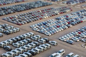 Dubai, UAE - January 03, 2017:  New cars in rows stored at port Rashid in Dubai, UAE