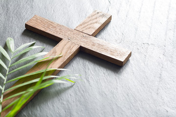 Fototapeta Easter wooden cross on black marble background religion abstract palm sunday concept  obraz