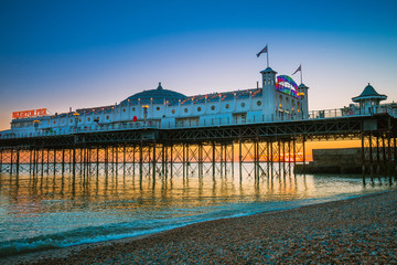 Brighton Pier beach with sunset golden hour at Sussex England, UK. Brighton Marine Palace and Pier popular place for visitor.
