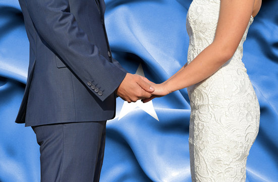 Husband and Wife holding hands - Conceptual photograph of marriage in Somalia
