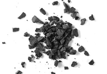 Black coal pile isolated on white background, top view