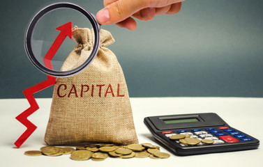Money bag with the word Capital and an up arrow. The concept of accumulation and increase in money capital. Increase in capital gains taxes. Increase in the number value of the company's shares.