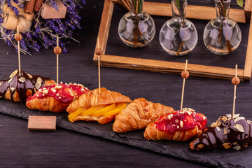 Sweet croissants with raspberry and chocolate