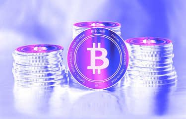 Bitcoin (BTC) digital crypto currency. Stack of coins. Cyber money.