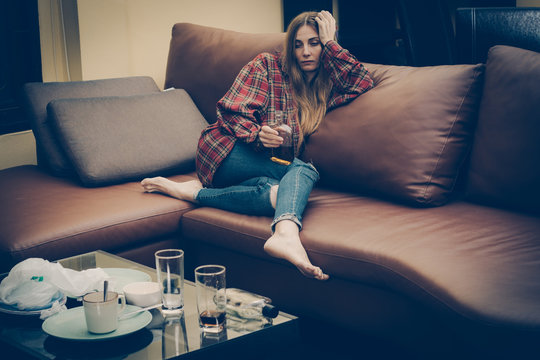 Young drunk woman on the sofa. Young drunk woman on the sofa. Alcoholism and drug addiction lead to depression.