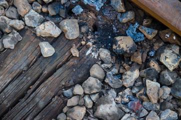 Worn Stones on Train Track