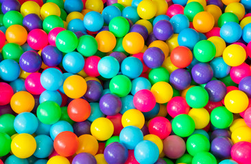 colourful plastic balls background for kid activity in indoor playground