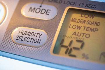 Air Purifier and dehumidifier. Concept for dehumidifying room. Humidity selection button. Humidity percentage display.