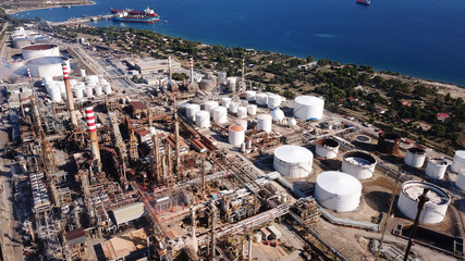 Aerial drone photo of working industrial oil refinery and power plant