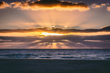 Sunset Rays Over Ocean