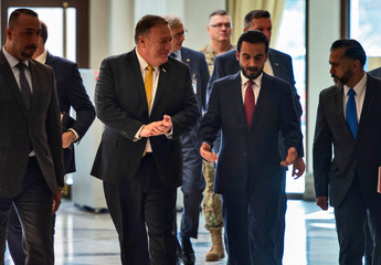 U.S. Secretary of State Mike Pompeo walks alongside Iraq's Parliament Speaker Mohamed al-Halbousi in Baghdad
