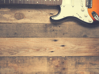 Old vintage guitar on rustic wood