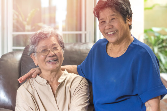 Happy senior society family concept. Portrait of Asian female older ageing women smiling with happiness in garden at home, wellbeing county or nursing home