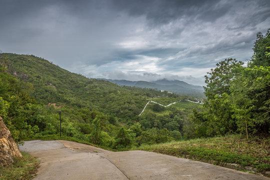 Dramatic stormy cloud sky above tropical mountains. Storm Pabuk, Thailand.