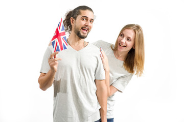 Hello! Happy couple in gray t-shirts with the flag of Great Britain, isolated on white background. Young people, man and woman. Learn English.