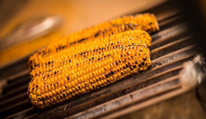Close up of cobs on grill toasting