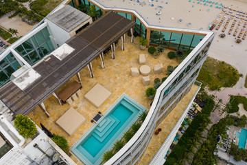 Aerial image of a rooftop swimming pool highrise architecture