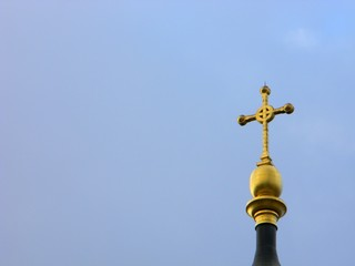 Golden cross on top of one of the bell towers of St. Istvan (St. Stephen's) Basilica, Budapest, Hungary