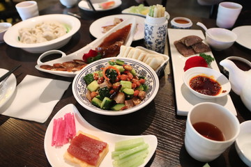 Traditional Chinese dishes on a table in a restaurant in Beijing China