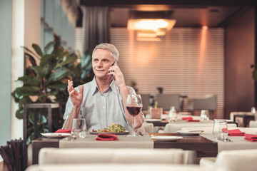 Serious man drinking wine in a restaurant