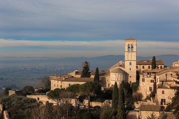 assisi is a city in Umbria, in Italy. It is surrounded by hills, olive groves and vineyards