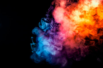 The thick smoke exhaled from the vape is highlighted by a blue-violet orange color like a rainbow...