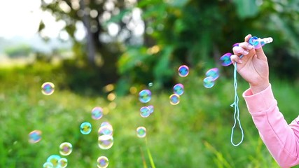 Wall Mural - Slow motion of blowing soap bubbles