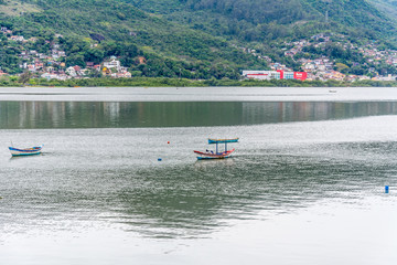 Small fisher boats on water, in Florianopolis, Brazil.