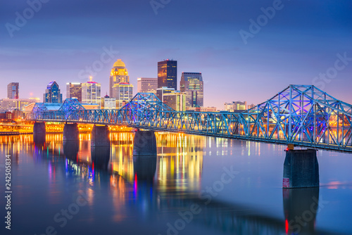 Wall mural Louisville, Kentucky, USA downtown skyline on the Ohio River at dusk.