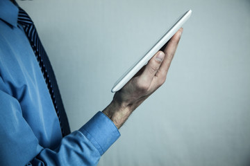 Man holding white digital tablet. Concept of new technology