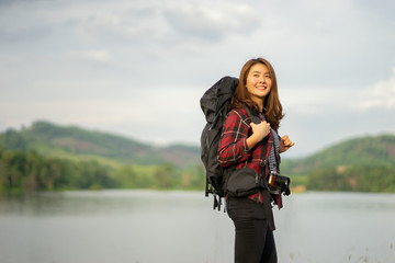 happy smiling wanderlust Asian women tourist hipster backpack to travel and rise hand in green wild forest trip hiking outdoor vacation make a journey holiday,nature lifestyle, Traveler hike concept