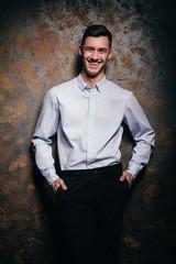 Handsome man, dark background, man in shirt, male portrait