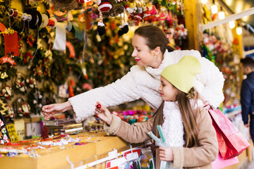 woman with little daughter at Christmas market
