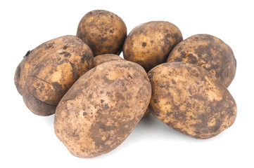 Heap of fresh organic potatoes on white background