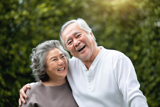Senior Couple laughing at the park.