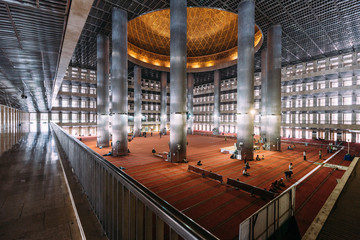 Masjid Istiqlal Interior with prayers in Indonesia is the largest mosque in Southeast Asia. Named