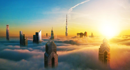 Keuken foto achterwand Dubai Dubai sunset view of downtown covered with clouds